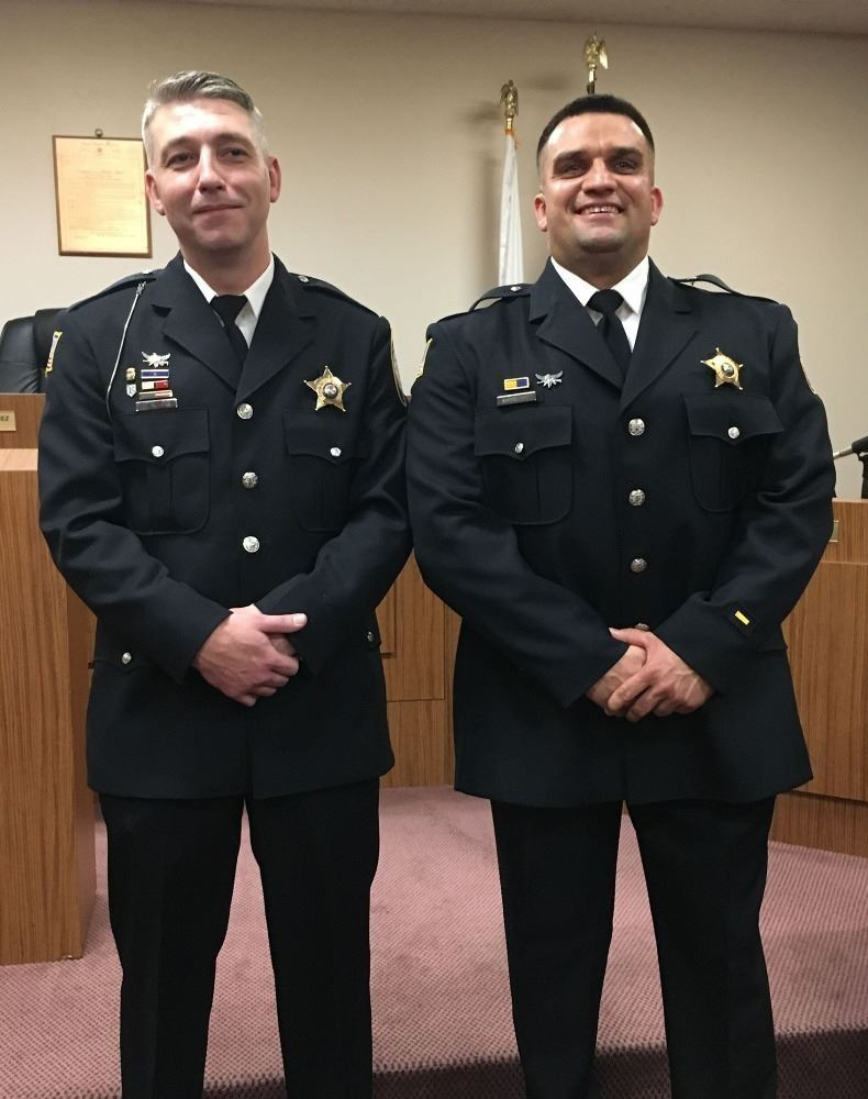 Sergeant Flinchum and Sergeant Makowski standing for photos at the Village board meeting on December