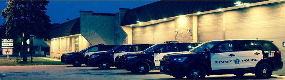 Four police cruisers parked in lot